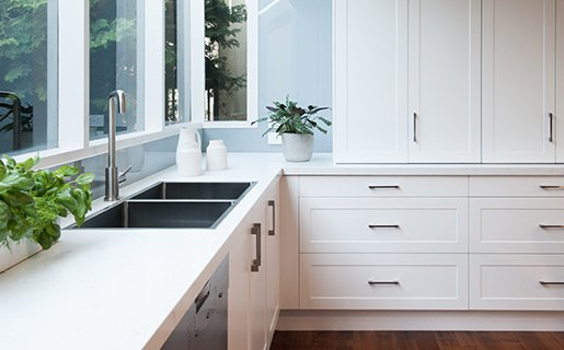 white hampton kitchen with handles and sink