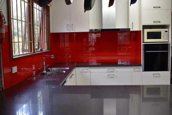 red splashback white kitchen