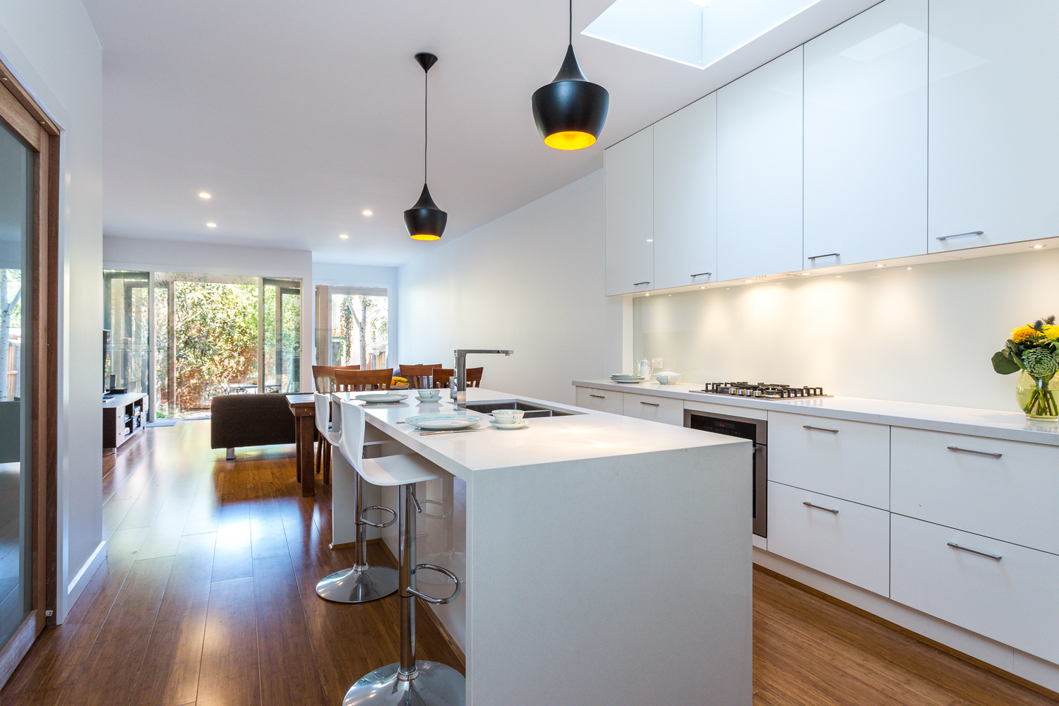 white kitchen with black pendant lights