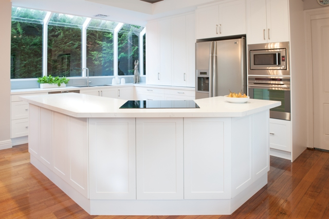 white hampton kitchen with fridge