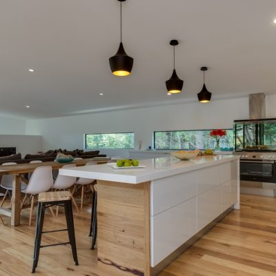 white gloss kitchen with timber floors