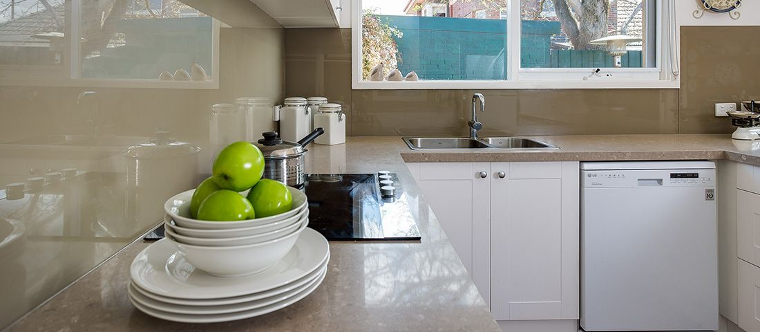 white shaker kitchen with quartz benchtop