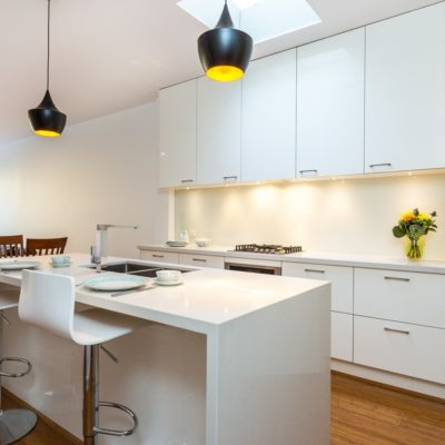 white gloss kitchen with corner pantry