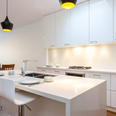 white kitchen with kitchen island