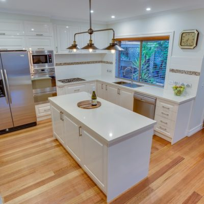 hampton style kitchen with island bench