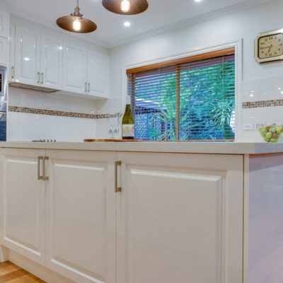 white kitchen with double ovens