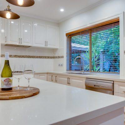 white gloss hampton style kitchen