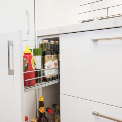 slide out kitchen cupboard with condiments