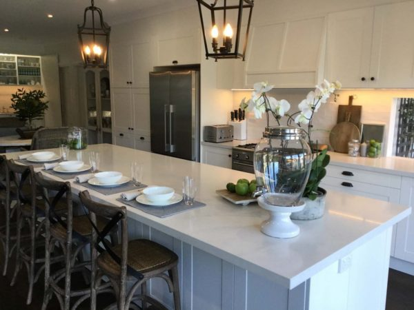 hamptons style white kitchen with pendant lights