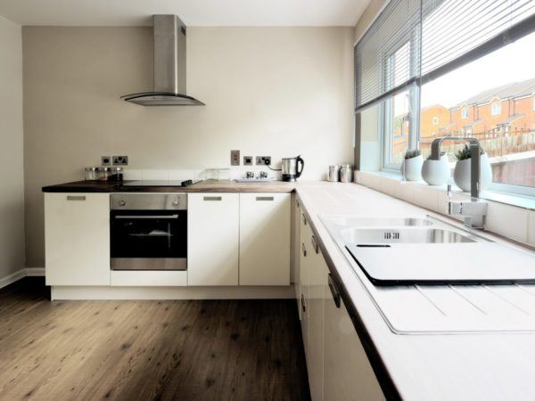 white ktichen with timber benchtop