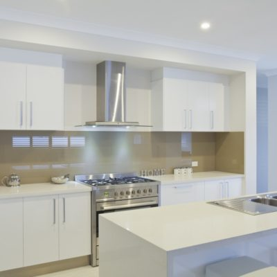 white kitchen with glass splashback