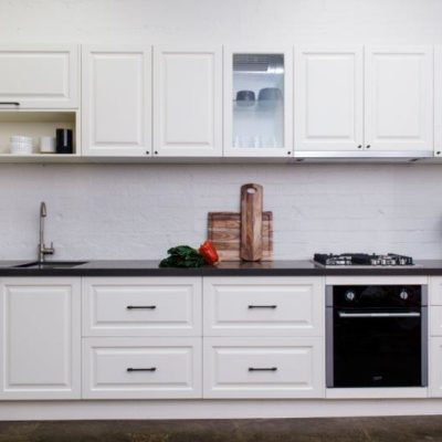 white shaker style kitchen with black benchtop