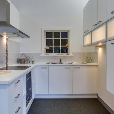white kitchen with canopy style rangehood