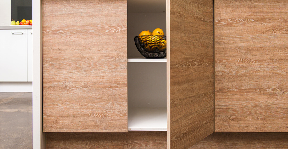 wooden kitchen cabinet with fruit bowl inside