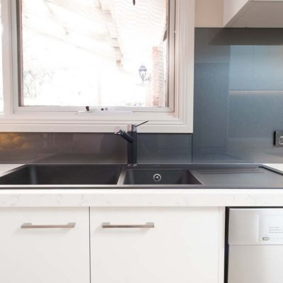 white kitchen in Ringwood North with sink and dishwasher