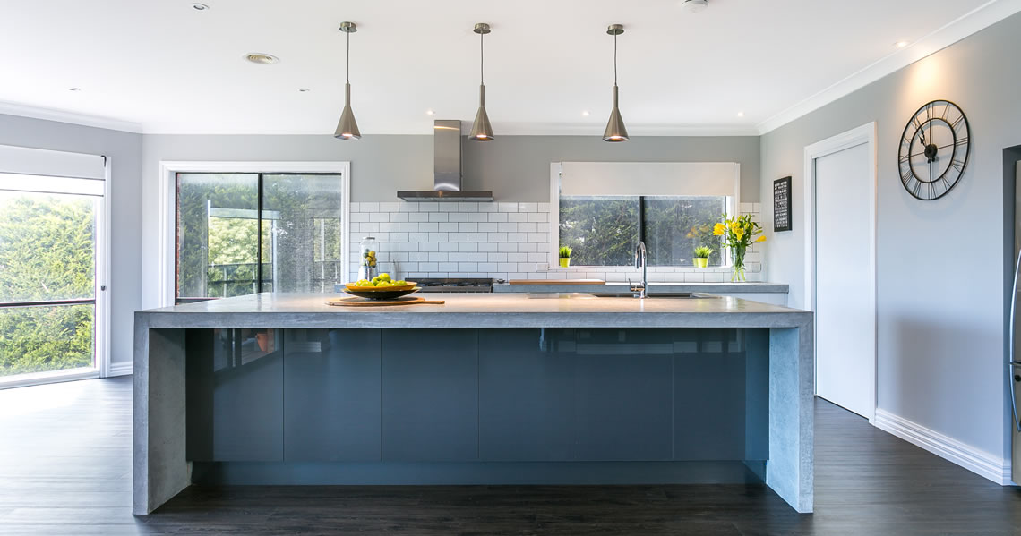 grey kitchen island with concrete benchtop