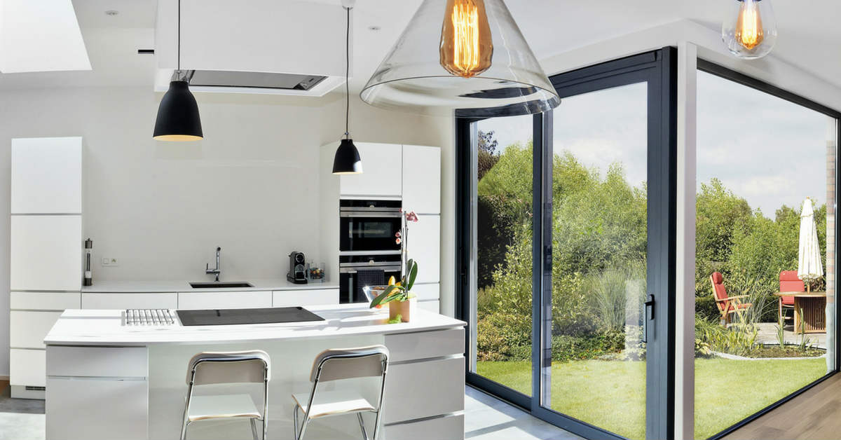 white kitchen with glass and black pendant lights
