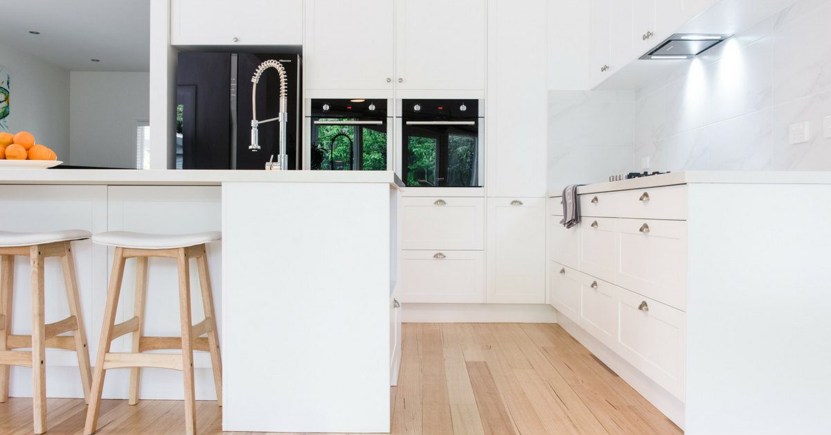 white shaker style kitchen with shell handles
