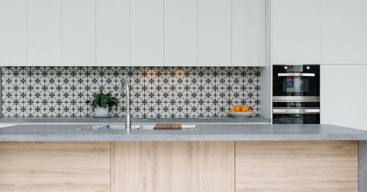 white and timber kitchen with patterned tiles