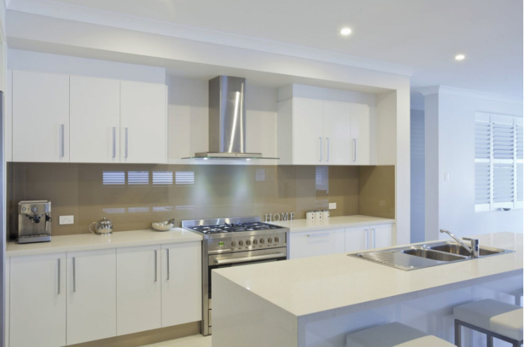 Modern kitchen with grey counter top and graphic tiled splash back