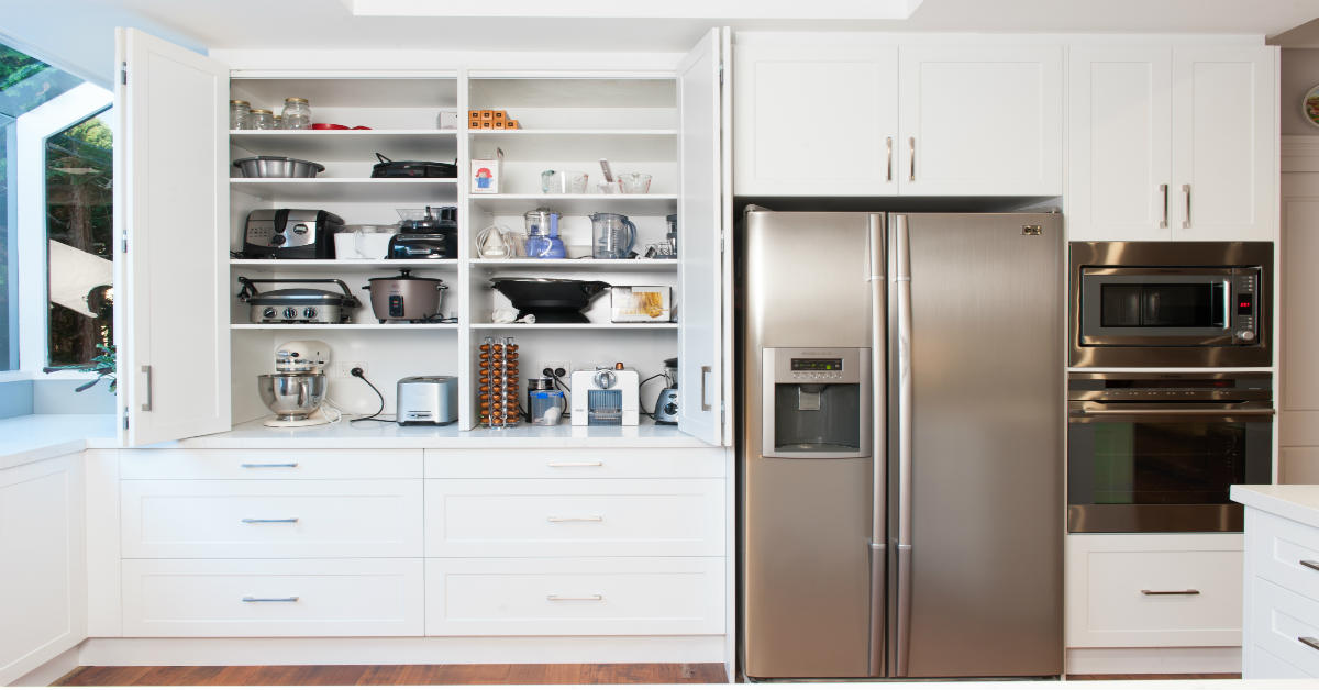 White kitchen with tall shelving