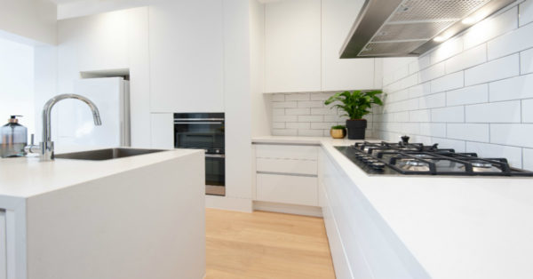 handleless kitchen with black appliances