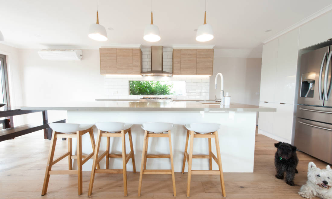 white kitchen with timber overhead cabinets
