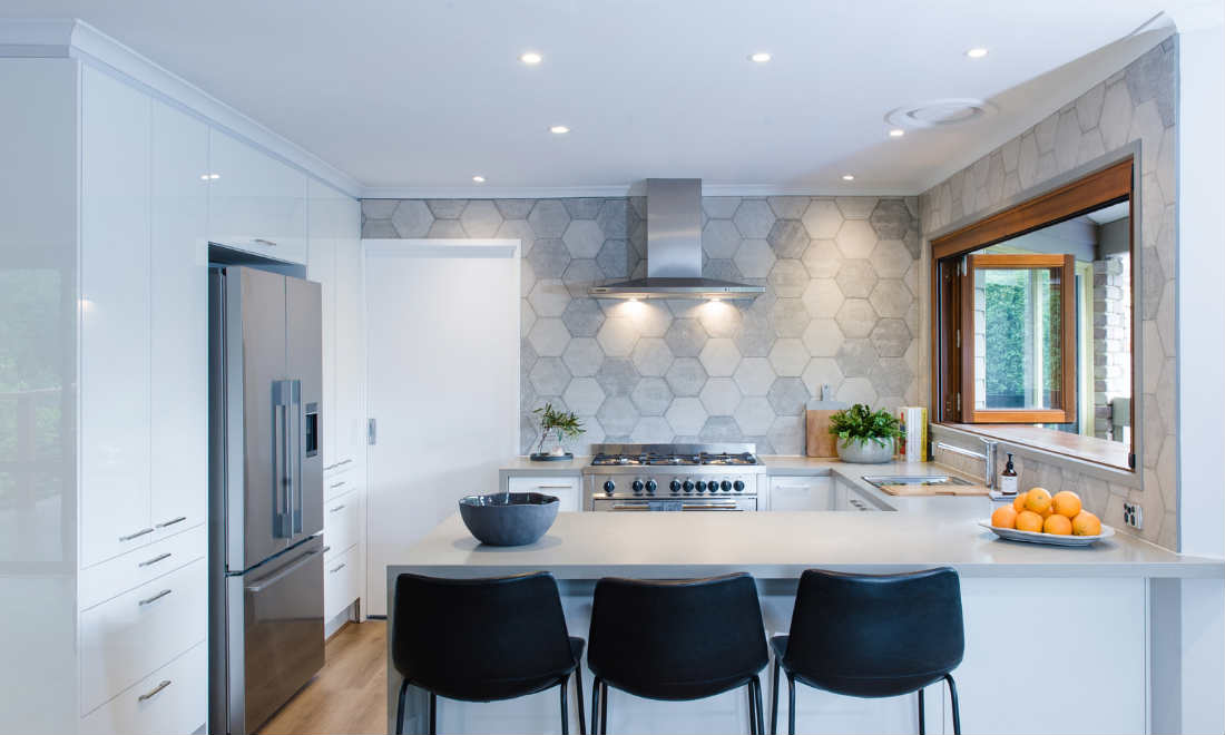 white kitchen with hexagonal splashback