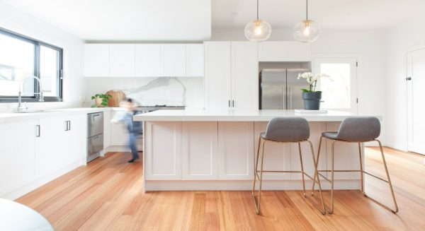 White kitchen with timber floor and benchtop