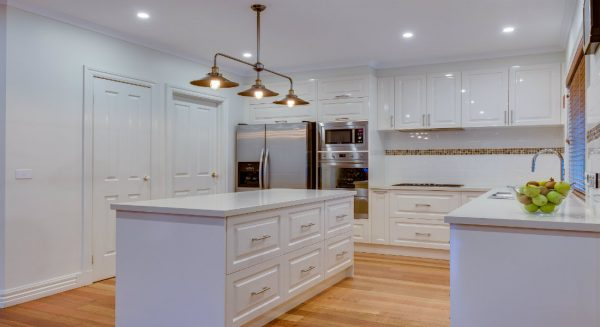 Traditional kitchen with timber floor and cabinetry