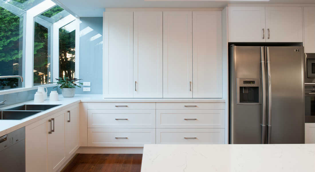 white modern kitchen with cabinets and appliances