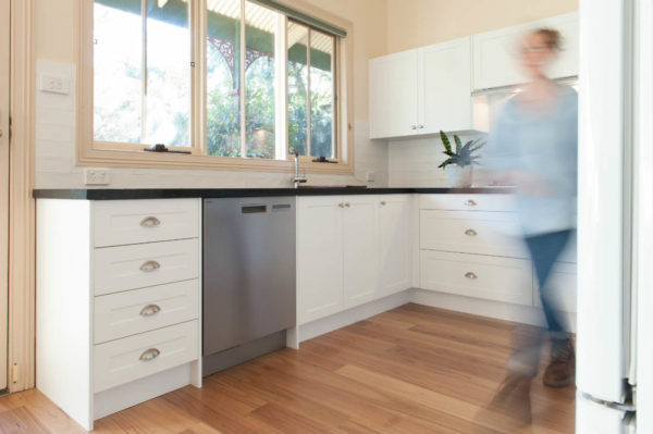 White kitchen with timber floor