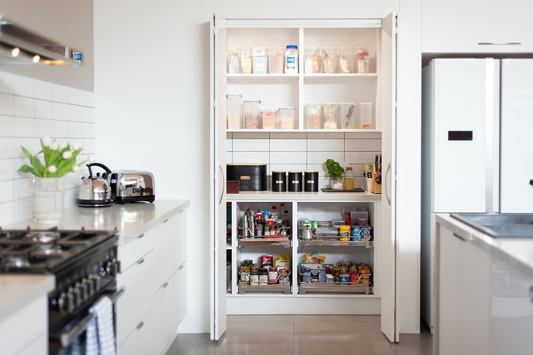 Pantry with consertina doors to keep kitchen organised