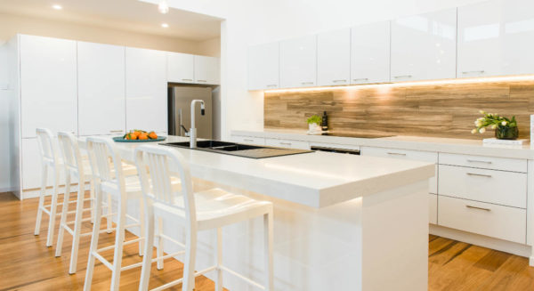 White kitchen with contrasting splashback