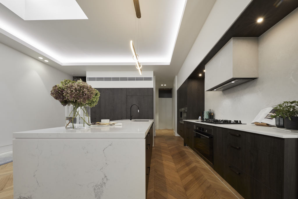 black and white kitchen with timber floor