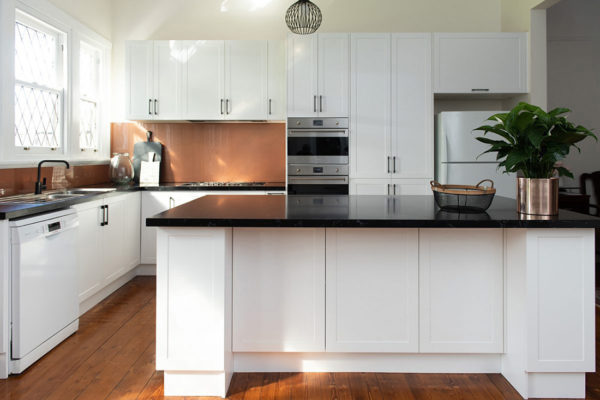 White kitchen with dark benchtops