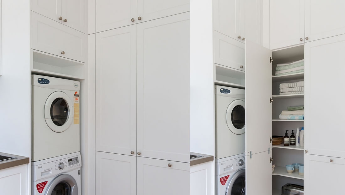 Hidden laundry in butlers pantry