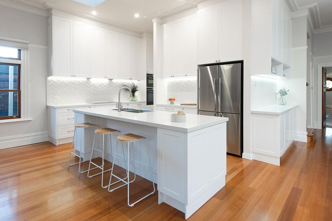 White hampton kitchen with timber flooring