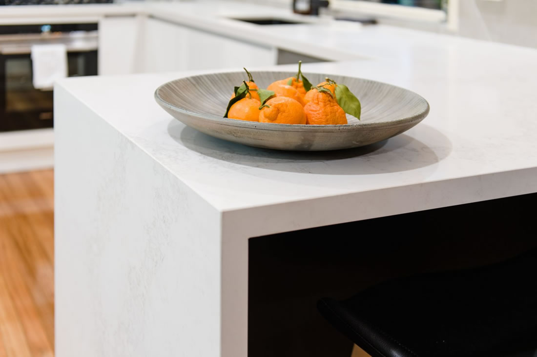 White Caesarstone benchtop with black cabinetry