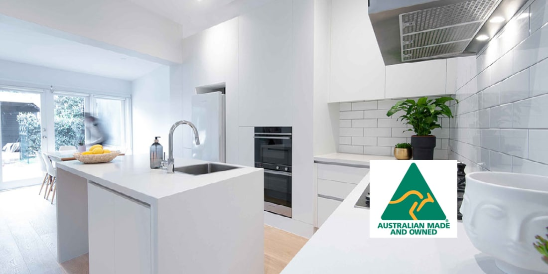 White kitchen with angled island bench