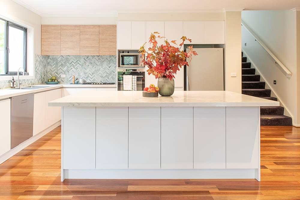white kitchen with herringbone tile